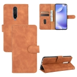 For Xiaomi Redmi K30 Ultra Solid Color Skin Feel Magnetic Buckle Horizontal Flip Calf Texture PU Leather Case with Holder & Card Slots & Wallet(Brown)