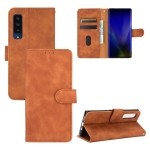 For Fujitsu Arrows NX9 F-52A Solid Color Skin Feel Magnetic Buckle Horizontal Flip Calf Texture PU Leather Case with Holder & Card Slots & Wallet(Brown)